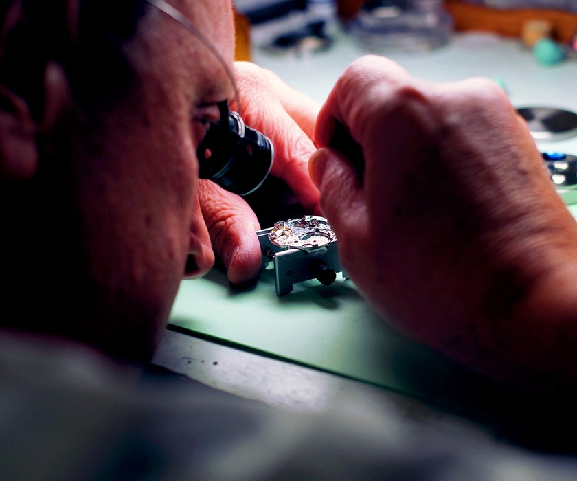 Jeweler working on a watch