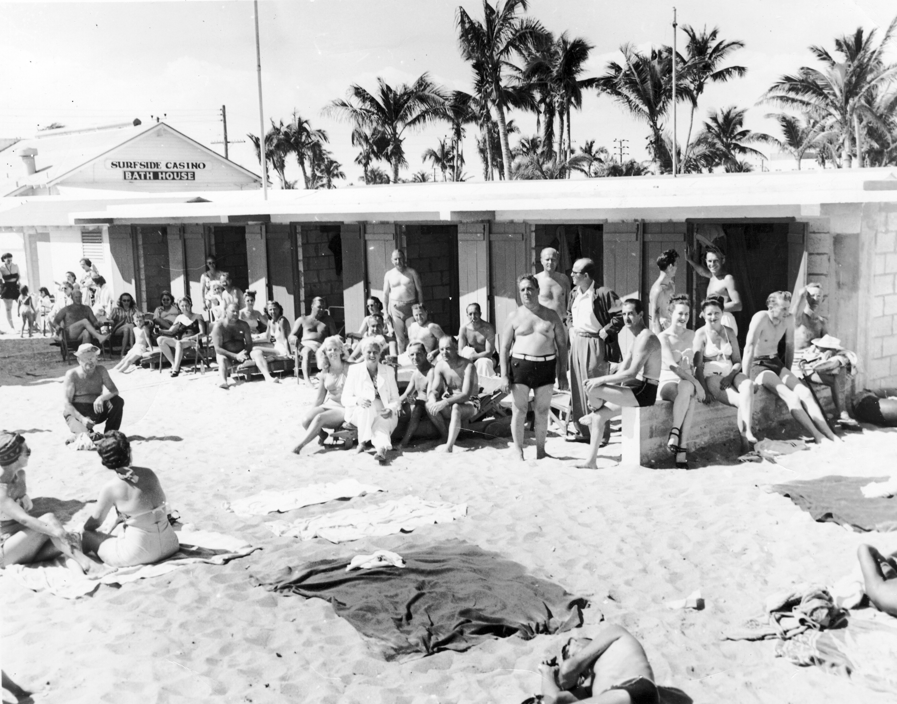 Beachgoers sitting and standing outside the Surfside Casino Bath House, circa 1950s. South Florida Photograph Collection, HistoryMiami Museum, 2009-486-1.