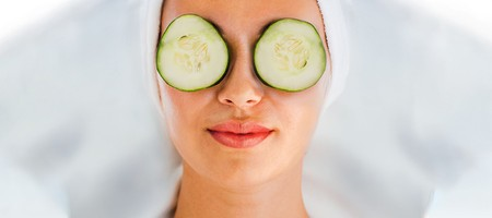 Woman with cucumbers over eyes
